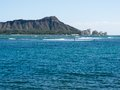 Diamond head from waikiki with ocean and surf in the foreground Royalty Free Stock Photography
