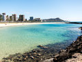 Diamond head from waikiki with shallow water in the foreground Royalty Free Stock Photo