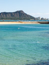 Diamond head from waikiki with shallow water in the foreground Royalty Free Stock Image