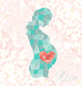 Diamond pregnant woman with heart in belly an origami style geometric a her stomach Stock Photos