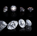 Diamond round brilliant cut perspective on black background Royalty Free Stock Photo