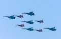 Diamond-shape of 4 Mig-29 The Russian Knights and five Su-27 Swifts Royalty Free Stock Photo