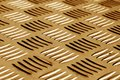 Diamond shaped metal floor pattern with blur effect in brown ton Royalty Free Stock Photo