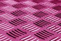 Diamond shaped metal floor pattern with blur effect in pink tone Royalty Free Stock Photo