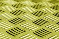 Diamond shaped metal floor pattern with blur effect in yellow to Royalty Free Stock Photo