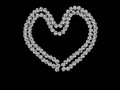 Diamond style heart, beads on black Royalty Free Stock Photos