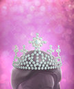 Diamonds crown on women head in pink glitter background the winner is the person who has beautiful possession worth of the Stock Photo