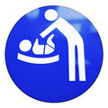 Diaper changing table sign at a door Royalty Free Stock Photo