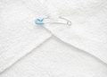 Diaper pin or cloth nappy safety pin blue inserted into folded Stock Photos