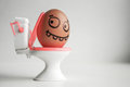 Diarrhea. Funny eggs with painted face concept Royalty Free Stock Photo