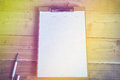 Diary blank and pen on wood background Stock Image