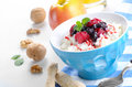 Diary breakfast with fruits cottage cheese in blue bowl raspberries blueberries and mint Royalty Free Stock Images