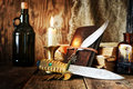 Diary and feather with a bottle of rum Royalty Free Stock Photo