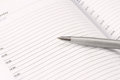 Diary with mortgaged pen on white background Royalty Free Stock Photo