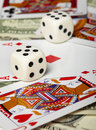 Dice against of playing cards and money Royalty Free Stock Photography