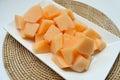 Dice cantaloupe fresh fruit cutting ready to eat Stock Photos