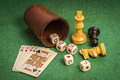 Dice Cup with Deck Cards and Chess Pieces Royalty Free Stock Photo
