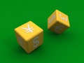 Dice with currency symbols at their sides Royalty Free Stock Photos