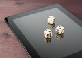 Dice on digital tablet pc texas game online old wood table concept of Royalty Free Stock Photography