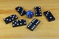 Dice and dominoes stones on a wooden surface Royalty Free Stock Images