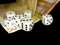 Dice and European banknotes money on black background, gambling Royalty Free Stock Photo