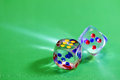 Dice gambling games of chance green background Royalty Free Stock Images