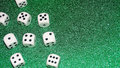Dice with a green background. Gambling concept. Royalty Free Stock Photo