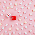 Dice with hearts and rows of marshmellow Royalty Free Stock Photo