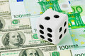 Dice on money background Royalty Free Stock Images