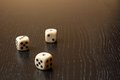Dice on old wood table detail of with warm light Royalty Free Stock Image