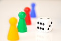 Dice and pawns four blurred Royalty Free Stock Photography