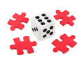Dice and puzzle isolated on white background Royalty Free Stock Photography