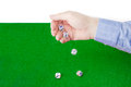 Dice thrown from male hand on table with green cloth Royalty Free Stock Photo