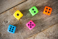 Dice on the wooden floor colorful old Stock Photo