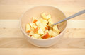 Diced apples beige bowl silver spoon Stock Images