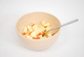 Diced apples beige bowl silver spoon Stock Photos