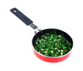 Diced chives garlic in saute pan on white sliced and and Stock Image