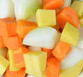 Diced potatoes, onions and carrots. Royalty Free Stock Photo