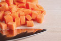 Diced raw carrots with knife Royalty Free Stock Photos
