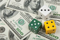 Dices of different colors on money background Royalty Free Stock Photo
