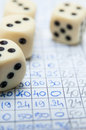 Dices and score filled up paper of the social game of yatzy Royalty Free Stock Photography