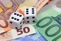 Dices thrown on euro money Stock Image