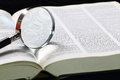 Dictionary and magnifying glass with an on top Stock Photo