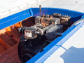 Diesel boat engine old in hull of small wooden fishing caique clinker greece Stock Images