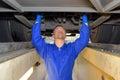 Diesel mechanic fixing vehicle Royalty Free Stock Photo