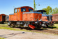 Diesel train two red locomotives side by side on railroad tracks these are in working order and are waiting for a new mission on Stock Image