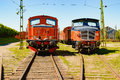 Diesel train two red locomotives side by side on railroad tracks these are in working order and are waiting for a new mission on Royalty Free Stock Photos