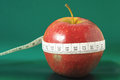 Diet apple measuring tape wrapped around a red as a symbol of Stock Image