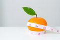 Diet concep, Orange fruit and measuring tape Royalty Free Stock Photo