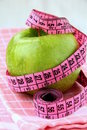 Diet concept  apple with measuring tape Royalty Free Stock Images
